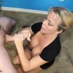 blonde babe jerks a cock with two hands