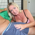 blonde milf caressing a big dick
