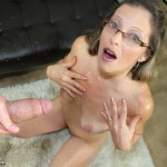 sexy brunette milf showered in cum